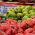 Different types of tomatoes on a table