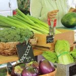 leeks, broccoli, eggplant and cabbage on a farm stand