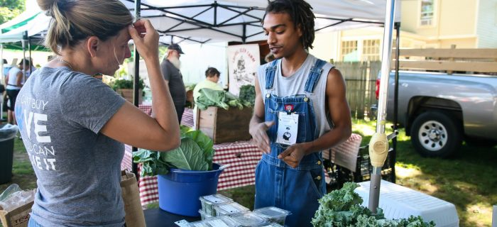 farmer talking to customer about micro-greens