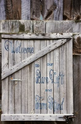 a sign that says welcome to our barn loft and farm stand